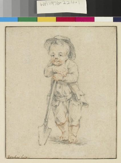 A boy leaning on a spade