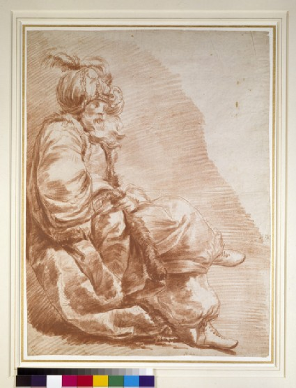 Recto: A seated figure, dressed for a Turkish masquerade<br />Verso: A seated figure in flowing robes