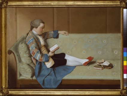 Portrait of a Man reclining on a Sofa, reading