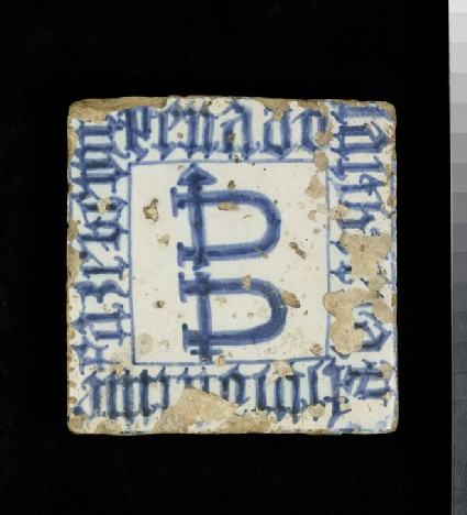 Tile with emblematic shackles and an inscription