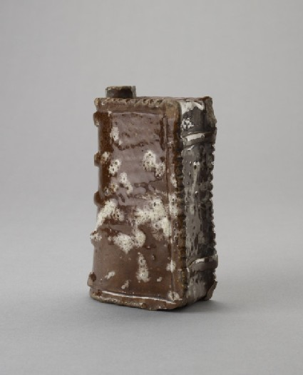 Flask or hand-warmer in the form of a book