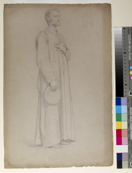 Figure of a man in buttoned tunic standing three quarter to right