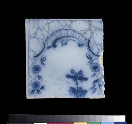 Tile with rococo cartouche and blue flowers