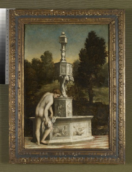 A young Man drying himself at a Fountain