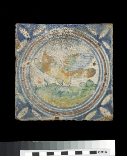 Tile with lapwing bird, wings outstretched