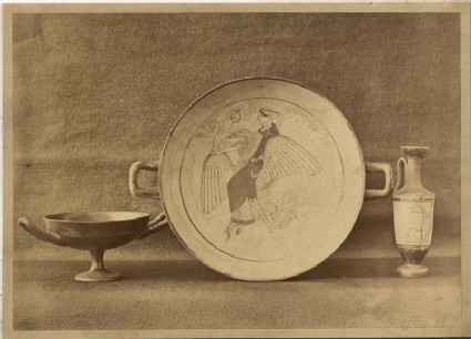 A Photograph of three Greek Ceramics, including a Patera showing Aphrodite riding a Swan