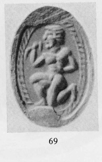 Carnelian scarab depicting naked youth drinking from a horn