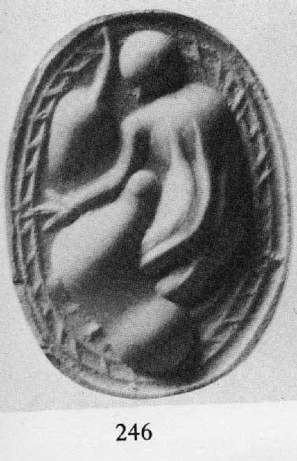 Scarab gem, figure stooped over animal