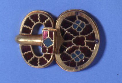 Large gold buckle with garnet and green glass inlays