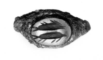 Intaglio gem, two fish, one above the other, in profile, set in a copper-alloy finger ring