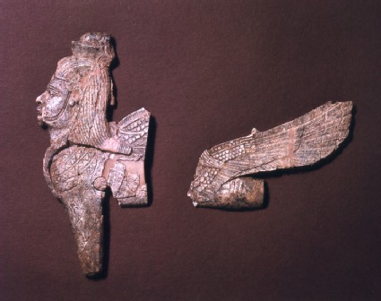 Ivory open work fragment part of a winged sphinx with crown, wig, pectoral and trace of a beard in Egyptian style
