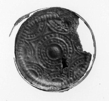 Applied brooch with bossed centre and two circles of raised dots with border lines
