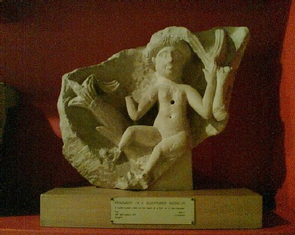 Relief of water nymph riding on a sea monster