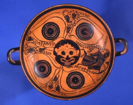 Attic black-figure pottery stemmed cup depicting a Dionysiac scene
