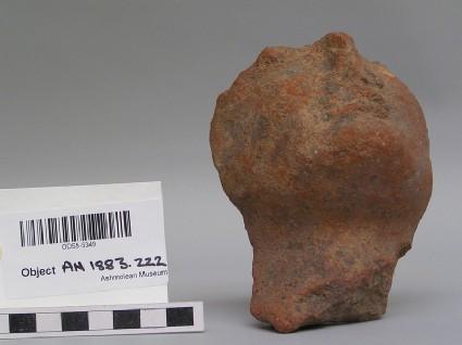 Female head, fragment, of large votive terracotta figure