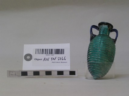 Bright blue or turquoise glass bottle