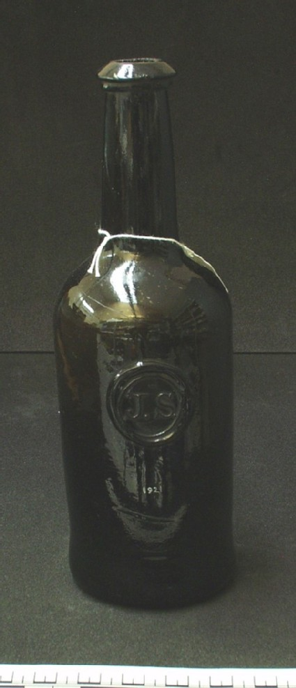 Wine bottle with college seal