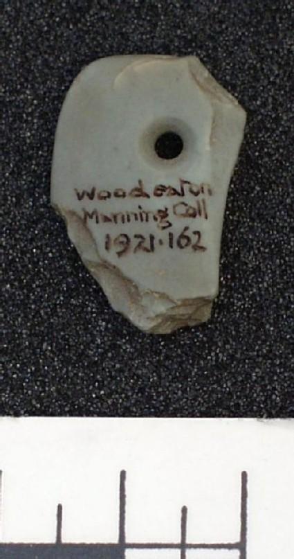 Fragment of schistone (slate) archer's wristguard