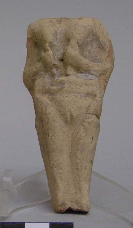 Fragment of a plaque with a female figurine
