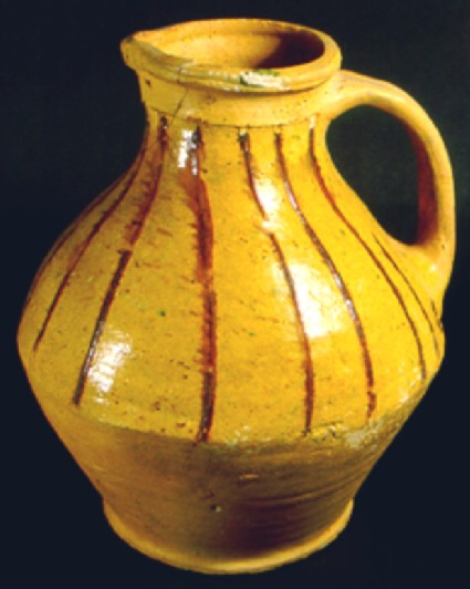 Biconical jug used for tableware decorated with vertical red strips
