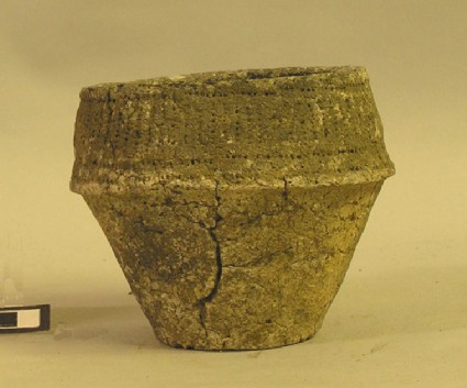 Bipartite collared urn, decorated with notched stamps, continuous lines and vertical strokes on collar
