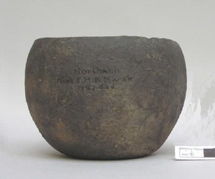 Bowl with barrel-shape profile, curving inwards towards rim and base