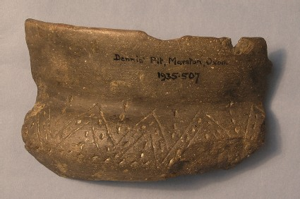 Sherd of round-bodied bowl