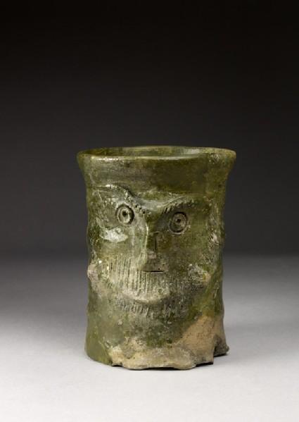 Cylindrical mug with face decoration