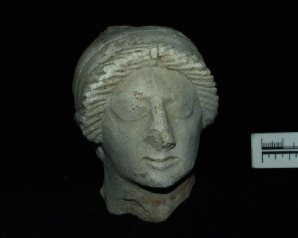 Limestone head of woman with sakkos, Cypriot style