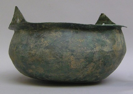 Bronze bowl with rim incorporating holes for hanging