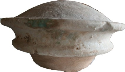 Glazed knob or wall plaque with traces of blue-green glaze over surface