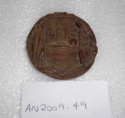 Discoid wooden plaque carved in relief with Christ and the Woman at the Well