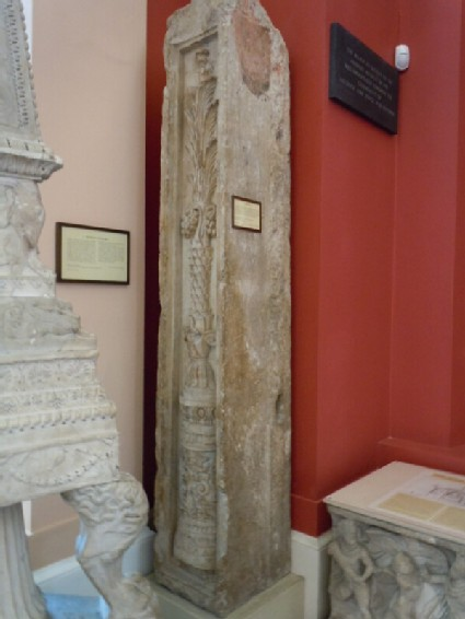 Fragment of pilaster carved with palmtrees and altar