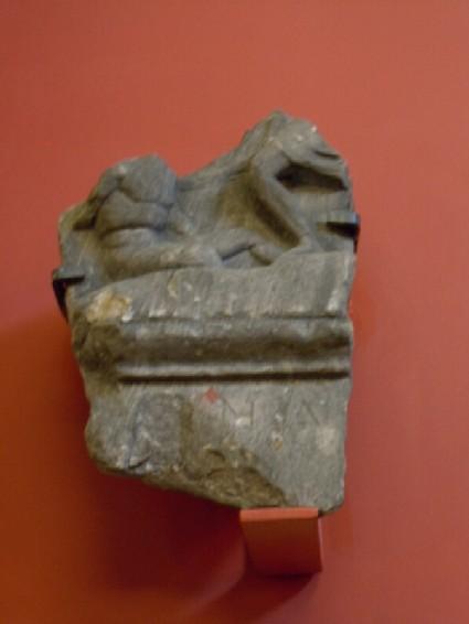Part of Attic grave stele showing fallen warrior, with inscription
