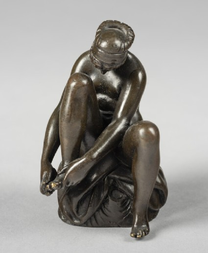 Nymph, seated on a tree-trunk, cutting her toenails