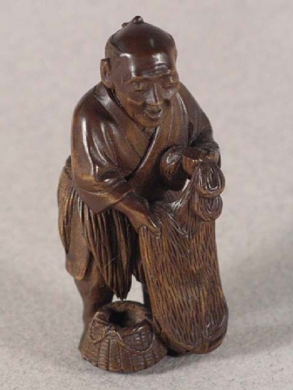 Netsuke in the form of a fisherman