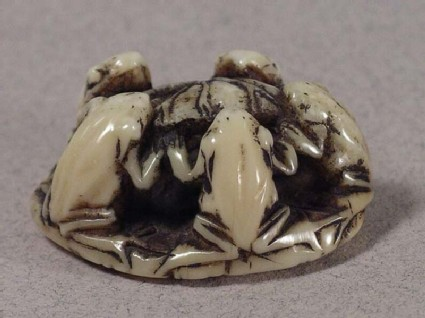 Netsuke in the form of five frogs seated around a lotus leaf