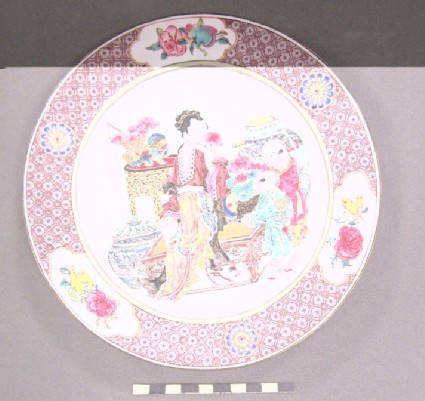 Dish with lady with two children, flowers, vases and tables. Mauve border, flower and fruit in reserves