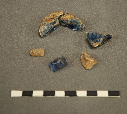 Six fragments of gilt moulded glass