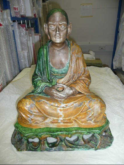 Seated monk with stand