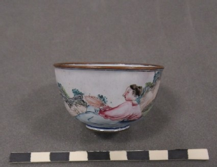 Small cup. Decoration of poet leaning beside a wine jar reading to another poet