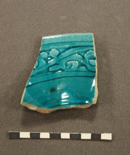 Fragment of a bowl with vegetal frieze