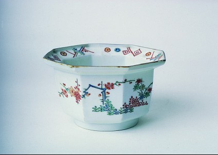 Octagonal bowl with bamboo, flowering plants, and decorated rim