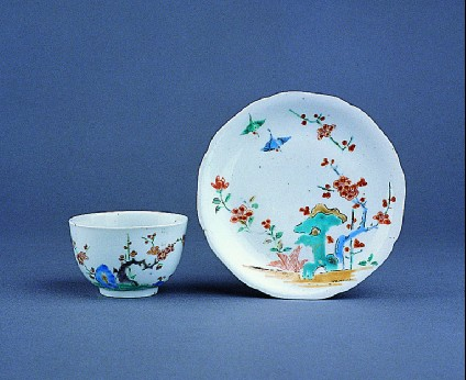 Cup with prunus, rocks and bird