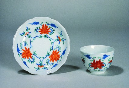 Cup and saucer with lotus blossoms linked by scrolls