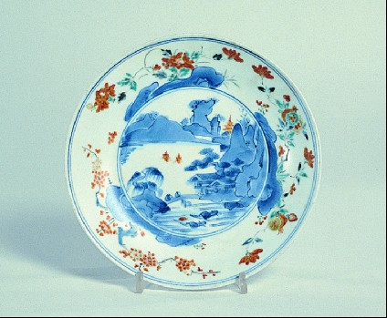Plate with mountainous landscape and floral border