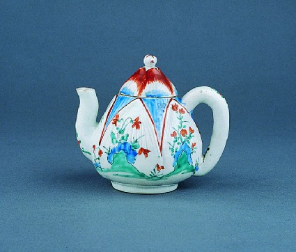 Tea pot in the shape of a lotus bud, with flowers and rockwork