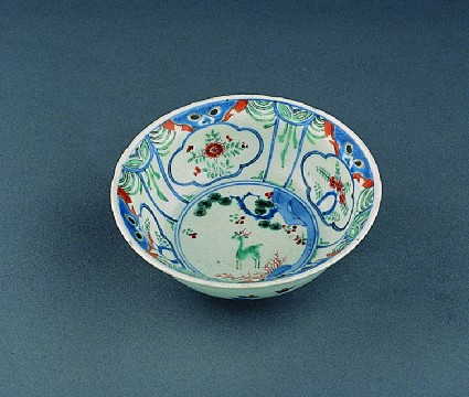 Bowl with stag under pine, and border of lion masks and flowers