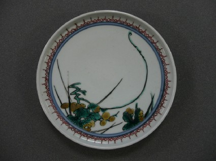 Circular plate with grapes, vine leaves and long tendril