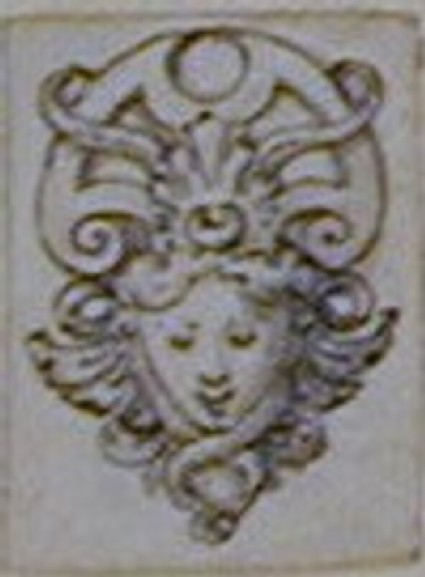 Design for an applied mask ornament: A design for an appliqué ornament in the form of a female mask